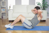Fit handsome man doing sit ups — Stock Photo