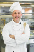 Mature head chef smiling at camera — Foto Stock