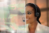 Pleased pretty businesswoman using futuristic interface hologram — Foto Stock