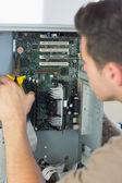 Computer engineer repairing open computer with pliers — Stock Photo