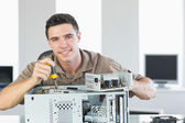 Handsome cheerful computer engineer repairing open computer — Stock Photo