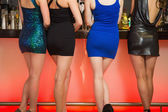 Sexy women legs standing at bar — Stock Photo