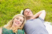 Sweet couple lying on a blanket — Stock Photo