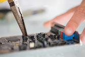 Extreme close up of pliers repairing hardware — Stock Photo