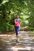 Lovely young woman jogging towards camera — Stock Photo