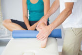Physiotherapist checking patients leg — Stock Photo