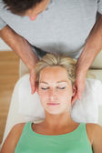 Physiotherapist massaging the head of a patient — Stock Photo