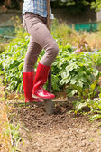 Woman working in the garden with a shovel — Stock Photo