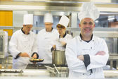 Mature male chef posing with crossed arms — Stock Photo