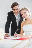 Portrait of pretty young couple signing wedding contract — Foto Stock