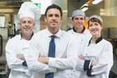 Restaurant manager standing in front of team of chefs — Foto Stock