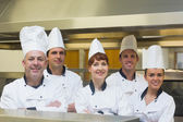 Five chefs posing with crossed arms — Stockfoto