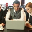 Colleagues working together while having coffee in a restaurant — Stockvideo