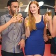 Well dressed friends clinking their bottles while having party together — Stock Video #33431371