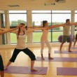 Fitness class and instructor doing yoga exercise — Stock Video #33431431