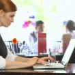 Serious businesswoman working on her laptop — Видео