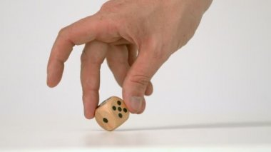 Hand letting twist a wooden dice — Stock Video