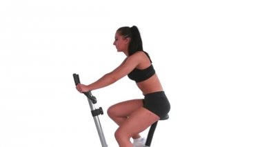 Tone brunette spinning on exercise bike — 图库视频影像