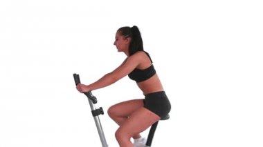 Tone brunette spinning on exercise bike — Stock Video