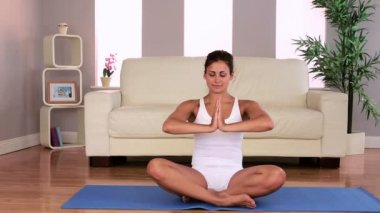 Fit attractive brunette doing yoga exercise in living room — Stock Video