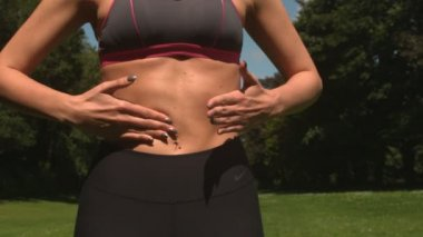 Tone woman touching abdominal muscle — Stock Video