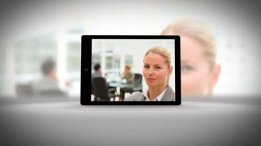 Tablet displaying business people — Vídeo Stock