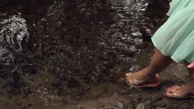 Close up of female feet dipping in water — Stock Video