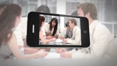 Smartphone displaying business people at work — Vídeo Stock