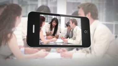 Smartphone displaying business people at work — Stock Video