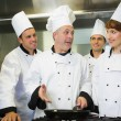 Experienced head chef explaining food to his colleagues — Stock Photo
