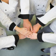 Stock Photo: Five chefs joining hands in circle