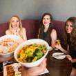 Happy friends looking at the salad — Stock Photo