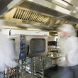 Team of chefs working in a commercial kitchen — Foto Stock