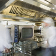 Team of chefs working in a commercial kitchen — Stok fotoğraf