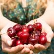 Close up of a blonde woman showing some cherries — Stock Photo