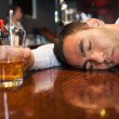Stock Photo: Drunk and unconscious businessmlying on counter