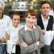 Cute female manager posing with the staff — Stock Photo #33441431