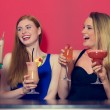 Attractive friends clubbing holding cocktails — Stock Photo