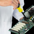 Extreme close up of computer engineer repairing hardware at night — Stock Photo