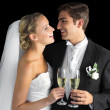 Cheerful married couple holding champagne glasses — Stock Photo