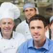 Young manager posing in a kitchen — Stock Photo