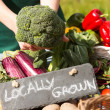 Stock Photo: Organic vegetables presented on stand for sale