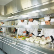 Four chefs working in a big kitchen — Foto de Stock