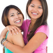Two beautiful sisters embracing each other  — Stock Photo