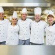 Five happy chefs smiling at the camera — Stock Photo #33445203