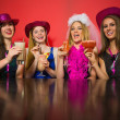 Laughing friends having hen party holding cocktails — Stock Photo