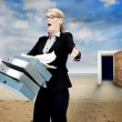 Foto Stock: Frustrated businesswomdropping folders