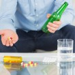 Close up of man showing pills and holding bottle — Stock Photo