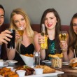 Friends having dinner together smiling at camera — Stock Photo