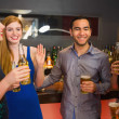Happy friends holding beers — Stock Photo #33446749